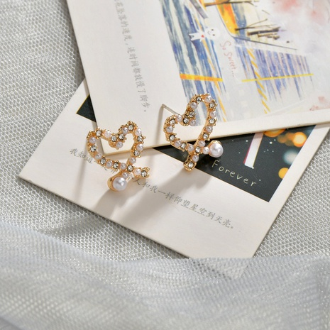 Korean  irregular hollow love pearl earrings  NHBQ292937's discount tags