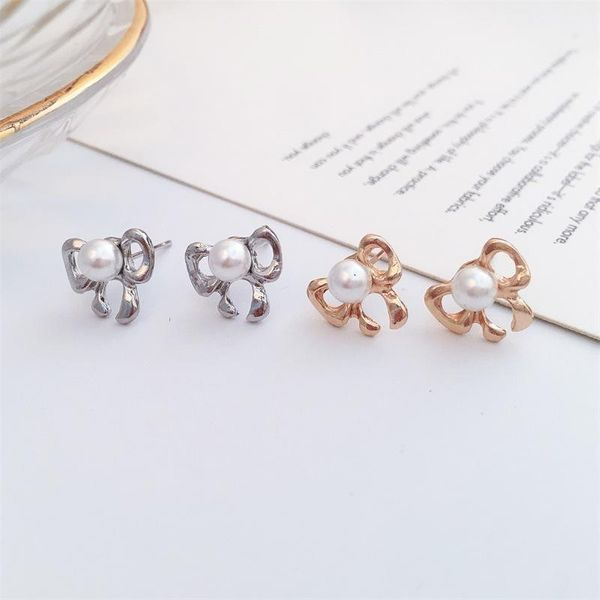 Korean new boutique ear jewelry wholesale simple pearl bow earrings bow tie earrings NHDP197155