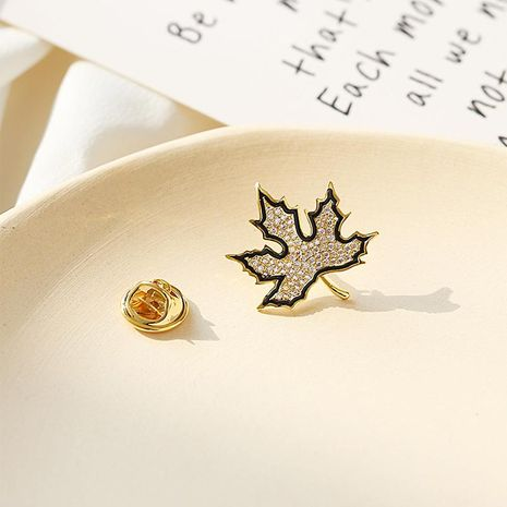 Maple leaf delicate brooch female cute anti-lightning V neckline wild simple suit shirt collar pin NHDO197322's discount tags