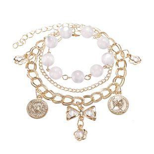 New Fashion Metal Disc Bow Crystal Pendant Bracelet Female White Beaded Multi-layer Bracelet NHPF196127's discount tags