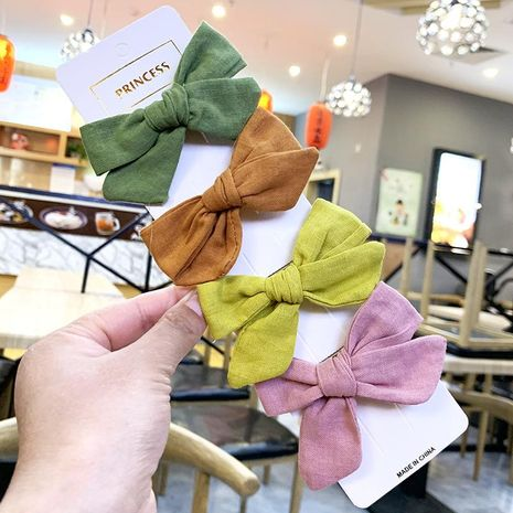 Children's solid color bow hair clip bangs clip cotton fabric bow hair clip NHSA201156's discount tags