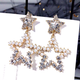 925 Silver Needle Fashion Metal Wild Hollow Double Pentagram Exaggerated Female Ear Studs NHSC201825