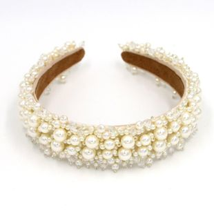 The new exquisite baroque fashion hair accessories headband hand-stitched pearl headband suppliers china NHCO202650's discount tags
