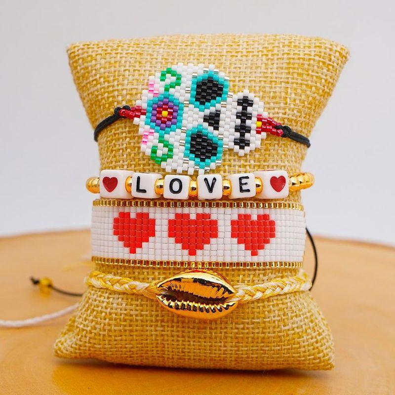 Fashion skull national style Miyuki rice beads hand-woven LOVE couple bracelet set of decorations supliers china NHGW202787