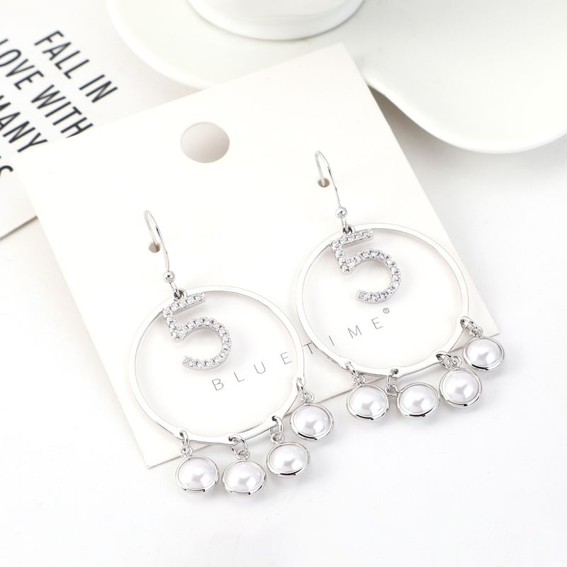 Korean fashion gold-plated retro pearl large circle hollow earrings wholesales yiwu suppliers china NHPS203163