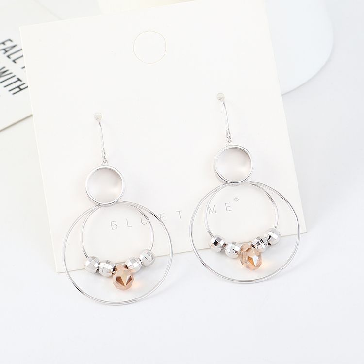 Korean simple and stylish gold plated crystal glass large circle hollow S925 silver pin earrings NHSE203190