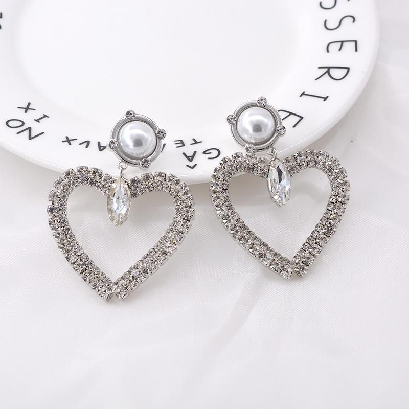 Simple love earrings female Korean big rhinestone pearl peach heart earrings ring exaggerated earrings NHNT203537