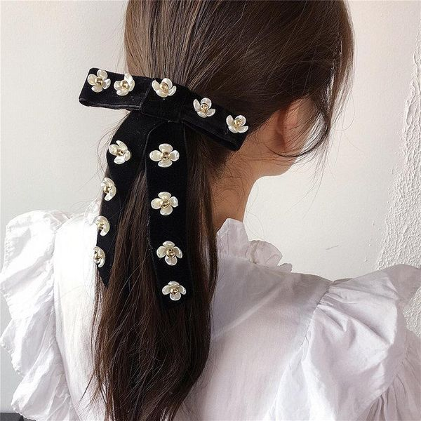 Korean velvet floret retro simple wild bow spring clip cheap steel clip wholesale NHHI203681
