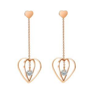 Nuevos aretes de corazón de circón con incrustaciones de acero de titanio Pendientes largos de borla chapados en oro rosa NHOP203694's discount tags