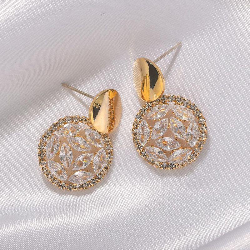 Nihaojewelry Fashion Exquisite Hollow Diamond Earrings Wild Round Silver Pin Earrings NHJQ199371