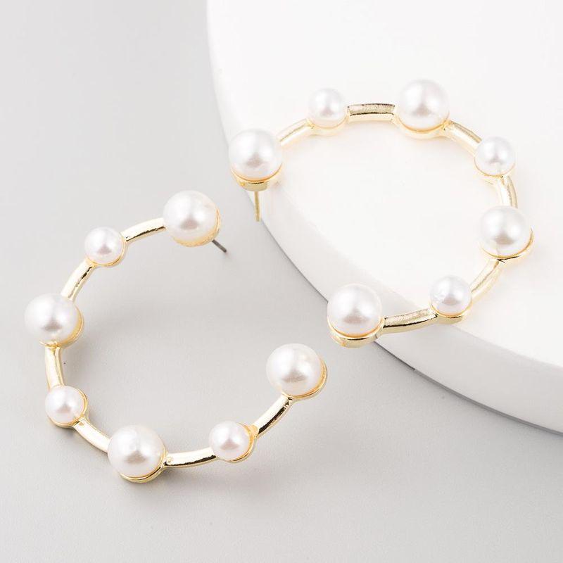 Korean fashion small fresh girl heart pearl simple C-shaped stud earrings NHLN199454