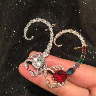 Nihaojewelry Fashion New Asymmetric Flash Diamond Scorpion Earrings Wholesale NHWK199586's discount tags
