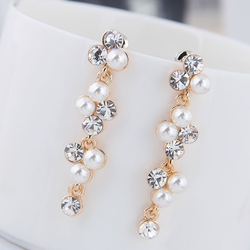Korean Fashion Metal Sweet Wild Rhinestone Pearl Earrings Wholesale NHSC204328