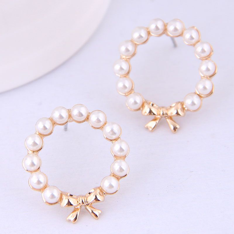 Korean fashion sweet OL simple bow pearl earrings for women wholesale NHSC204513
