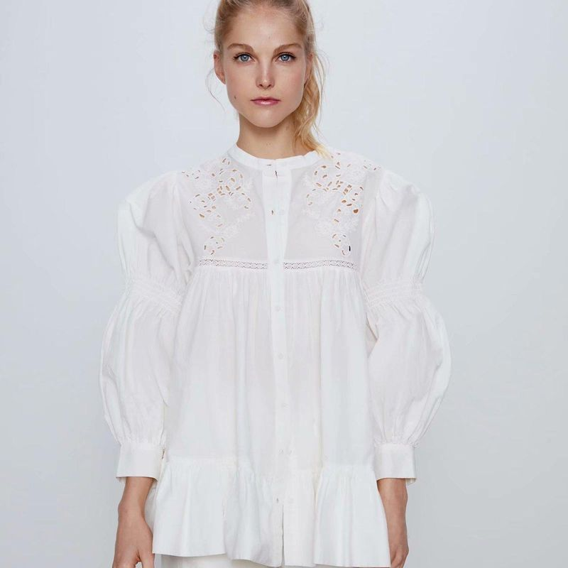 New Fashion Spring Hollow Embroidered Laminated Blouse Tops Wholesale NHAM204788