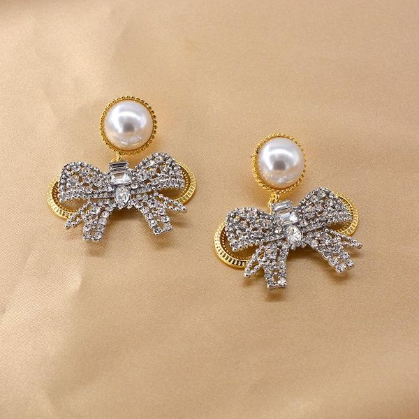 New Baroque Flash Diamond Elegant Pearl Bow 925 Silver Pin Earrings Wholesale NHNT205142