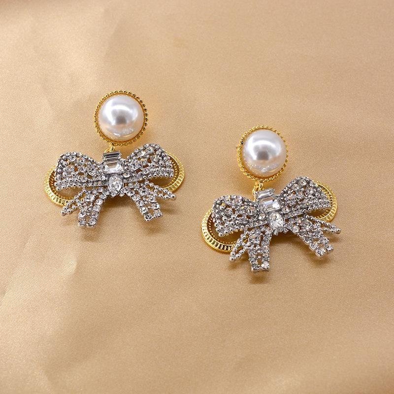New Baroque Flash Diamond Elegant Pearl Bow 925 Silver Pin Earrings Wholesale NHNT205142