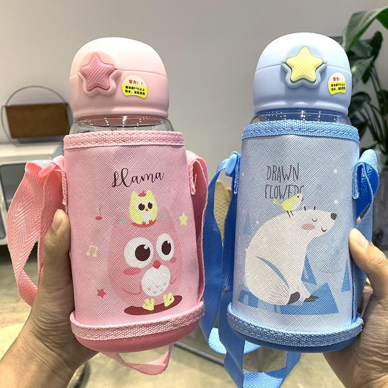 Simple Korean cute printed children's plastic water cup large capacity portable handle cup with cup cover anti-scalding water cup NHtn205376