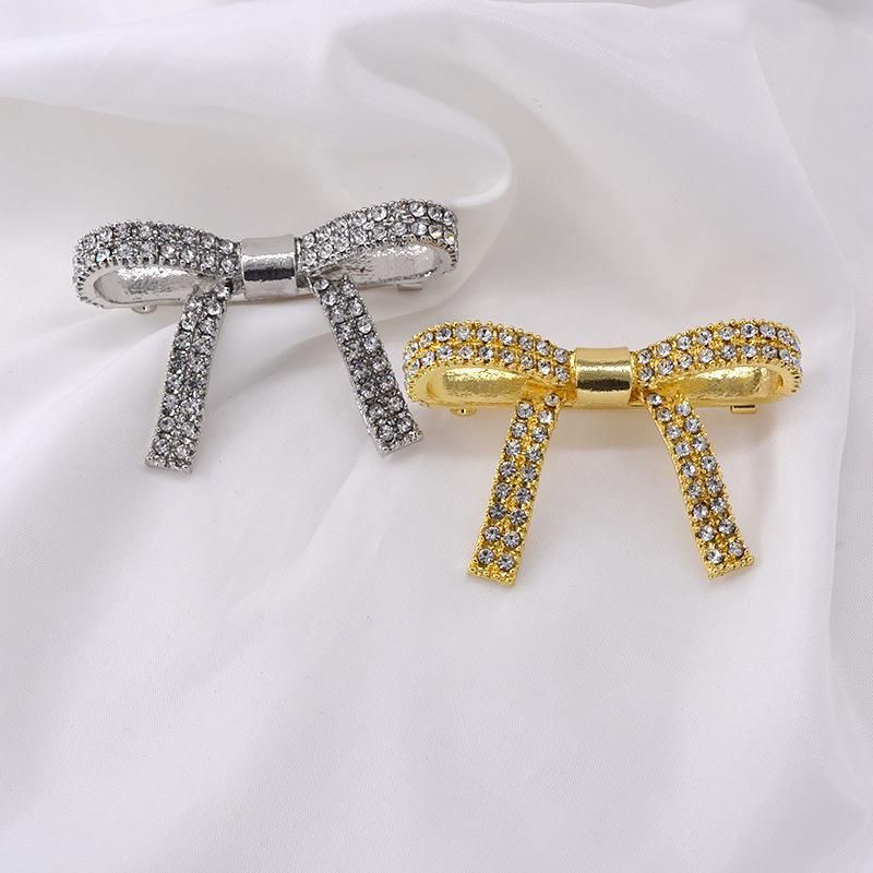 Fashion brooch bow brooch autumn and winter coat suit brooch accessories wholesale NHNT199793