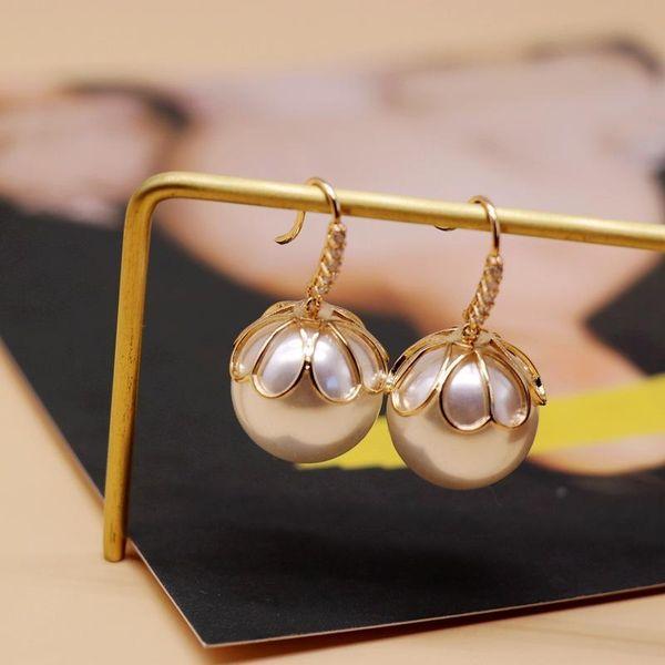 Fashion Hollow Metal Cap Pearl Earrings Flower Shaped Pearl Diamond Earrings NHOM199856