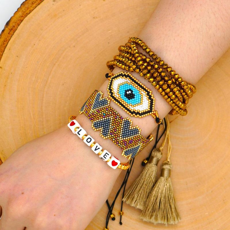 Fashion Love LOVE Hand-woven Miyuki Mizhu Evil Eye Crystal Tassel Female Bracelet NHGW205978