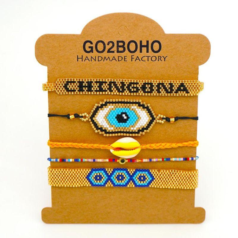 Miyuki Mizu Handwoven Evil Eye Ethnic Wind Shell Tassel Bracelet NHGW205989