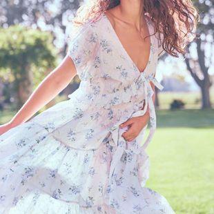 Fashion women's dress wholesale bow print V-neck vacation dress NHAM200115's discount tags