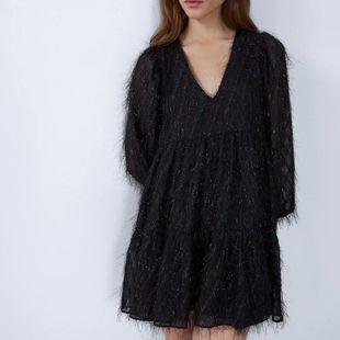 Fashion women's dress wholesale spring metallic thread fringed long sleeve dress NHAM200120's discount tags