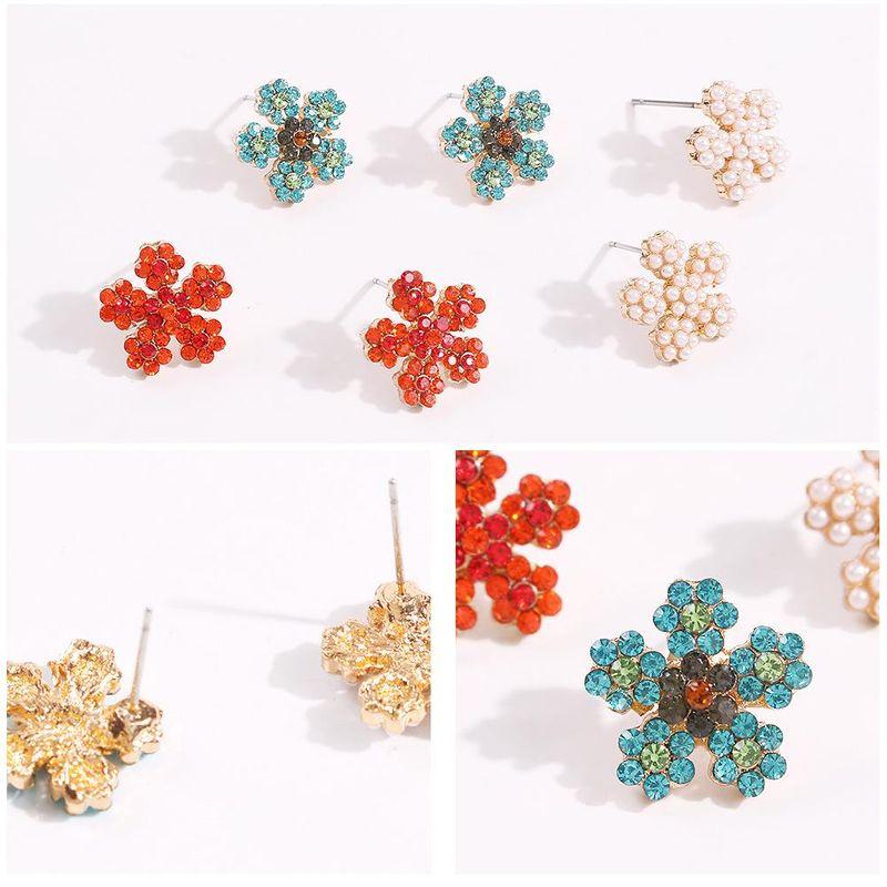 New niche creative colorful diamond earrings fashion geometric snowflake simple earrings NHMD200446