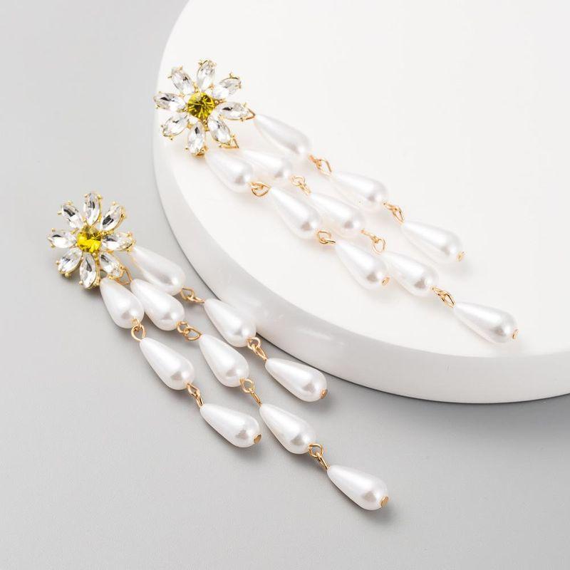 Fashion long tassel earrings female alloy pearl earrings diamond creative flower retro earrings NHLN200452