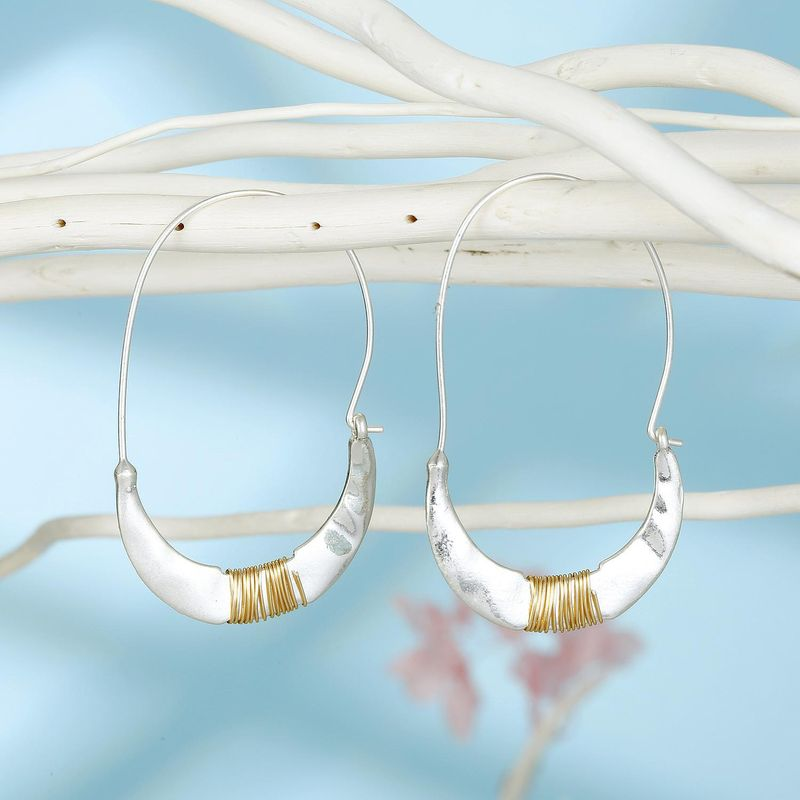 Jewelry vintage simple geometric alloy earrings hand-wound earrings NHGO201049