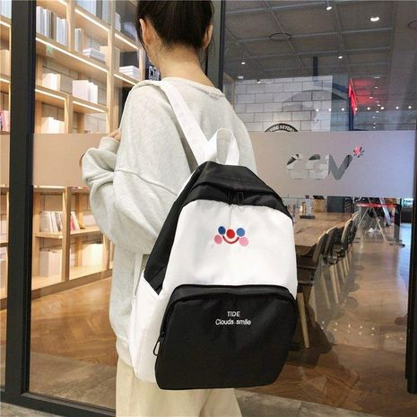 New fashion hit color embroidery smiley shoulder bag retro sense student campus backpack wholesale NHHX208549's discount tags