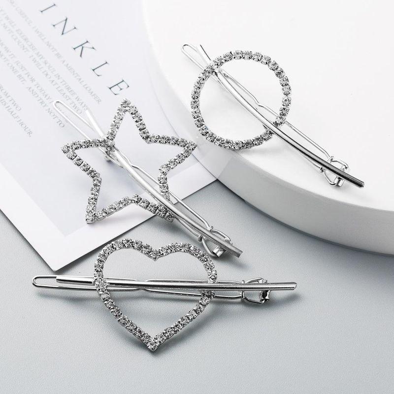 Korean new creative diamond hair clip alloy heart-shaped lady headdress simple hollow cheap side clip NHLN208870