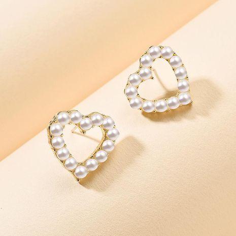 Han Xinpin Pearl Studs Fashion Geometric Love Flower 925 Earrings for Women Wholesale NHMD209213's discount tags