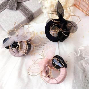 Korean new style twisted mesh three-dimensional flower wild yarn bow grab clip wholesale NHHI206601's discount tags