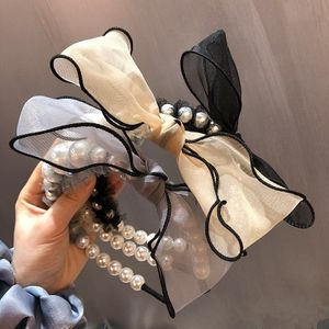 New Korean retro pearl yarn side bow simple hair hoop wholesale NHHI206612