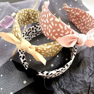 New leopard pattern simple wild color matching small ear headband women NHHI206624's discount tags