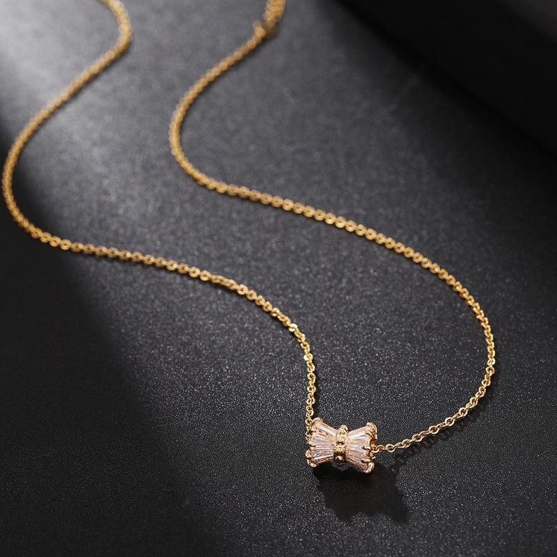 Korean sweet titanium steel zircon clavicle chain bow gold stainless steel short paragraph chain women NHJJ206739