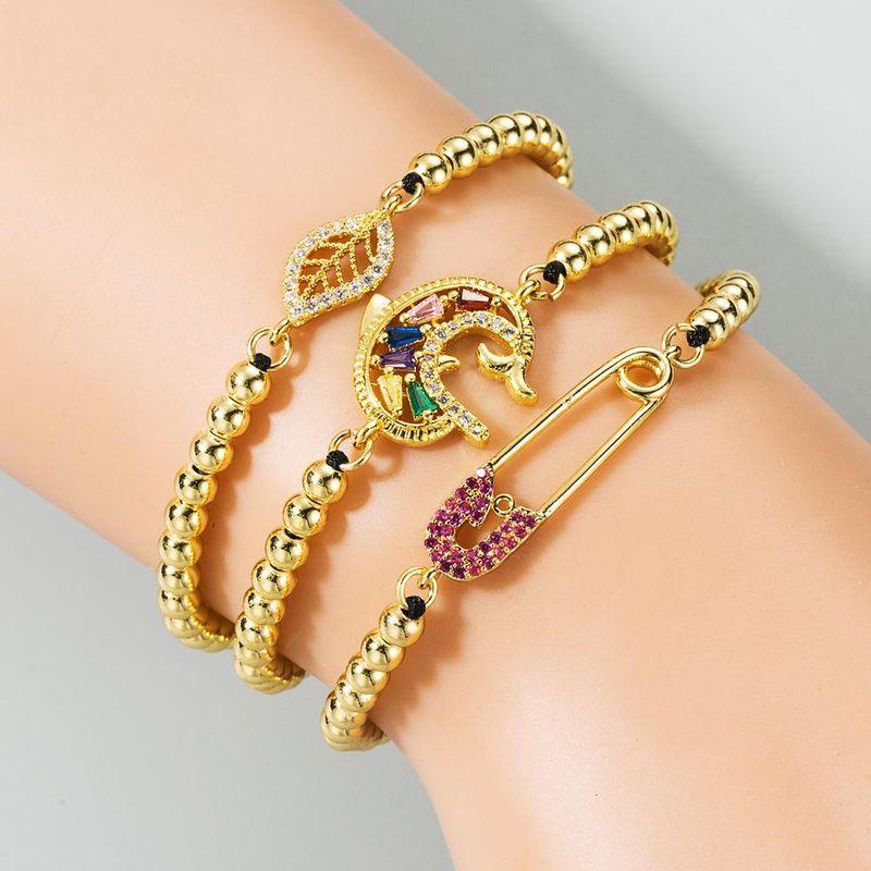 New fashion leaf paper clip copper inlaid zircon drawn copper beads black braided rainbow bracelet wholesale NHLN210577