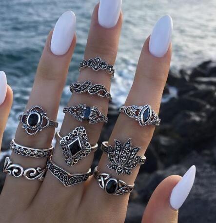 Mode rétro noir pierre gemme goutte d'eau diamant géométrique creux lotus set anneau 11 pièces ensemble NHGY210690's discount tags