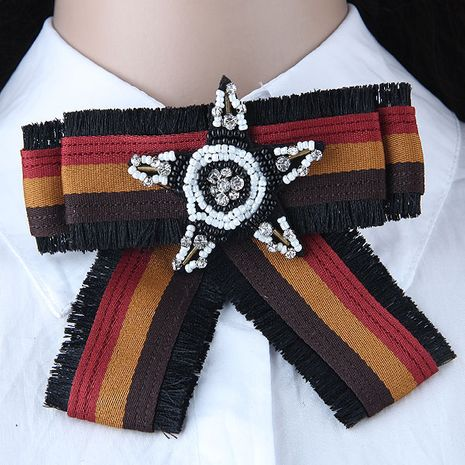 Simple bow knot versatile metal woven rice beads pentagram tassel accessories collar brooch yiwu nihaojewelry wholesale NHSC211272's discount tags