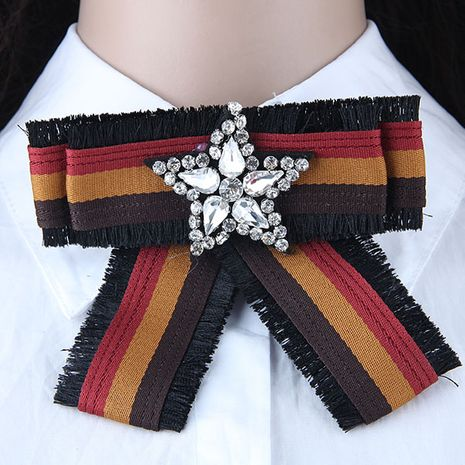 Simple bowknot wild metal shiny five-pointed star cloth tassel collar brooch yiwu nihaojewelry wholesale NHSC211268's discount tags