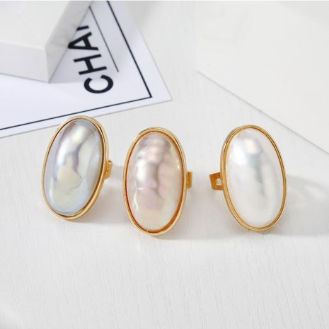 New fashion imitation mother-of-pearl ring exaggerated pearlescent adjustable ring wholesale NHGO211648's discount tags