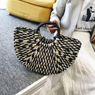 New fashion hand-woven bag bucket bag black and white thick strip bag wholesale NHGA211948's discount tags