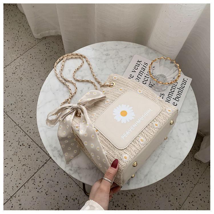 The new trendy fashion wild straw crossbody bag chain bucket bag wholesale NHTC212077