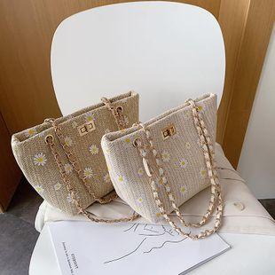 New spring Korean fashion wild woven chain small daisy lock bucket bag wholesale NHPB212119's discount tags