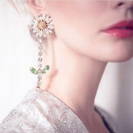 Korean new fashion creative diamond geometric sun flower earrings wholesale NHMD212454's discount tags