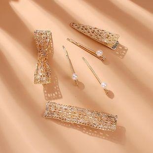 Korean New Fashion Creative Hollow Bowknot Edge Clip Pearl Slip Clip Set NHMD212465's discount tags