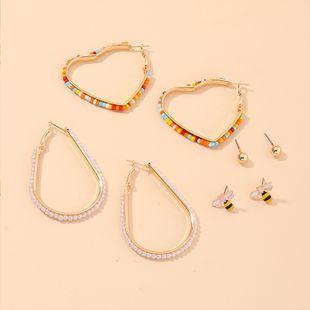 Nuevo bohemio étnico viento color arroz pendientes de perlas corazón de melocotón pendientes de perlas nihaojewelry al por mayor NHNZ213292's discount tags