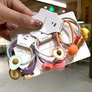 Nuevos accesorios para el cabello para niños nihaojewelry chicas coreanas al por mayor lindo lazo para el cabello banda de goma fruta cabeza cuerda hembra NHSA213326's discount tags